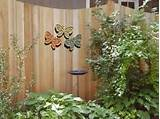 Brighten up a Garden Fence with Outdoor Wall Décor | Outdoor Wall