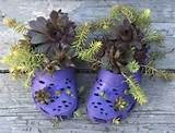 small plants growing in plastic shoes handmade garden decorations and