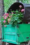 Antique Covered Wagon Planter Full Of Flowers