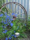 wagon wheel and flowers garden decor