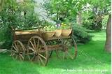 rustic horse drawn wagon used as garden decor and planter