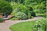 ... walkway through a peaceful perennial garden. Stock Photo - 9487870