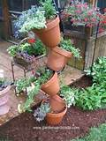 clayplanter5 225x300 container garden 004 topsy turvy container idea