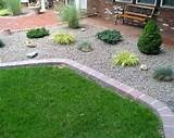 basic stone planting bed, done with small river rock