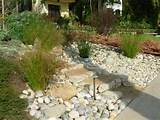 ... river-rock entry garden is installed above an in-ground infiltration
