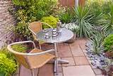 Patio and garden furniture in small enclosed outdoor room with plants ...