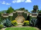 patio garden created with well trimmed grass beds and exotic plants