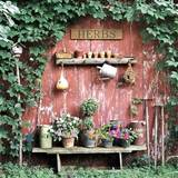 old garden tools and reclaimed wood for garden decorations