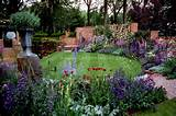 glorious upscale garden with lots of flowers in blue and purple color