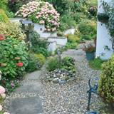 gravel garden with raised flower beds
