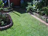 the ones flush with lawn are bedded and pointed in cement mortar as