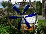 bottle wheels 001 300x225 blue bottle garden art ideas