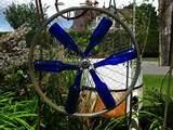 bottle wheels 001 300x225 Blue Bottle Garden Art Ideas