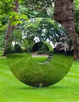 torus outdoor garden sculpture in stainless steel