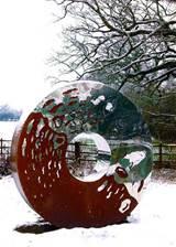 portal large garden sculpture in two interwoven metals