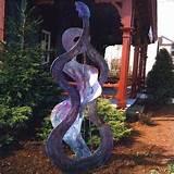 metal garden art the blues player