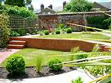 modern structural planting set in a traditional walled garden