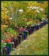 ... to upcycle glass bottles into a colorful border for a flower garden