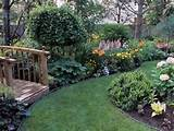 ... hanging flowerpots and flower bed, creative backyard landscaping ideas