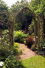 rustic wooden arch and trellis work at whit lenge garden hartlebury