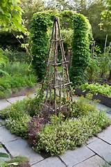 Rustic Tuteur -Trellis with herbs in the center of a Potager ...