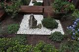 this small rock garden was influenced by zen meditation gardens