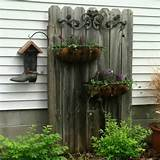 fence and wall decorating with flowers and metal ornaments