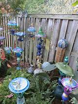 arranging diy garden ornaments for garden decorations