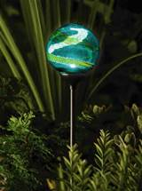 this solar powered garden globe by murano is an enchanting garden