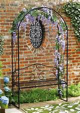 black metal garden arch trellis with bench