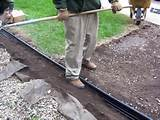 sides of the edging compact the backfill material along the edging