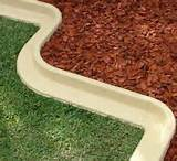 plastic or wood garden edging works well i would never pay for in
