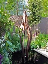 ... sculptures portal titan hammanim ether sculptures garden globe