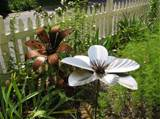 using a metal garden sculpture to create year round interest