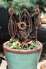 potsticker industrial art recycled steel rusty metal garden art