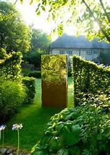 metal garden sculpture that interweaves earthy rustic oxidized steel