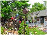 ... wonderful outbuildings that were covered with whimsical garden decor