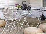 Otheroutdoor optionsinclude simplewhite furniturewith pouffes ...
