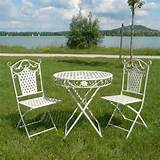 Garden furniture set in wrought iron - two chairs, a table