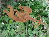 whimsical garden decor judie bomberger flying cupid whimsical