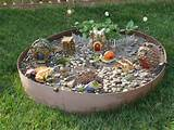 fairy garden can be hidden among your current garden or in
