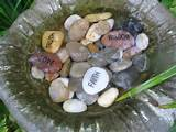 stones engraved with favourite words of inspiration fill this birdbath
