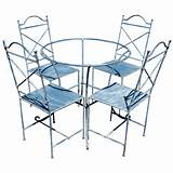 vintage wrought iron outdoor table and four chairs