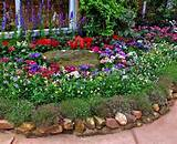 beautiful flower beds adding bright centerpieces to yard landscaping