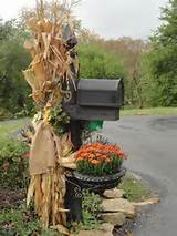Use corn stalks and flowers to give the mailbox a lovely fall look