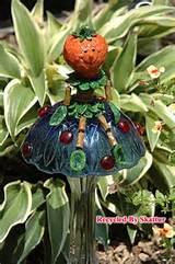 whimsical mushroom sitter stella strawberry garden yard art