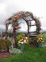 Garden wedding arbor with fall style decorations