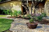 nice large rock landscaping ideas with fresh grass and pebble and