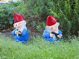 "... hand casts and paints these sinister gun-toting garden gnomes ."" Via"