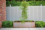 garden fence design ideas with exposed brick wall